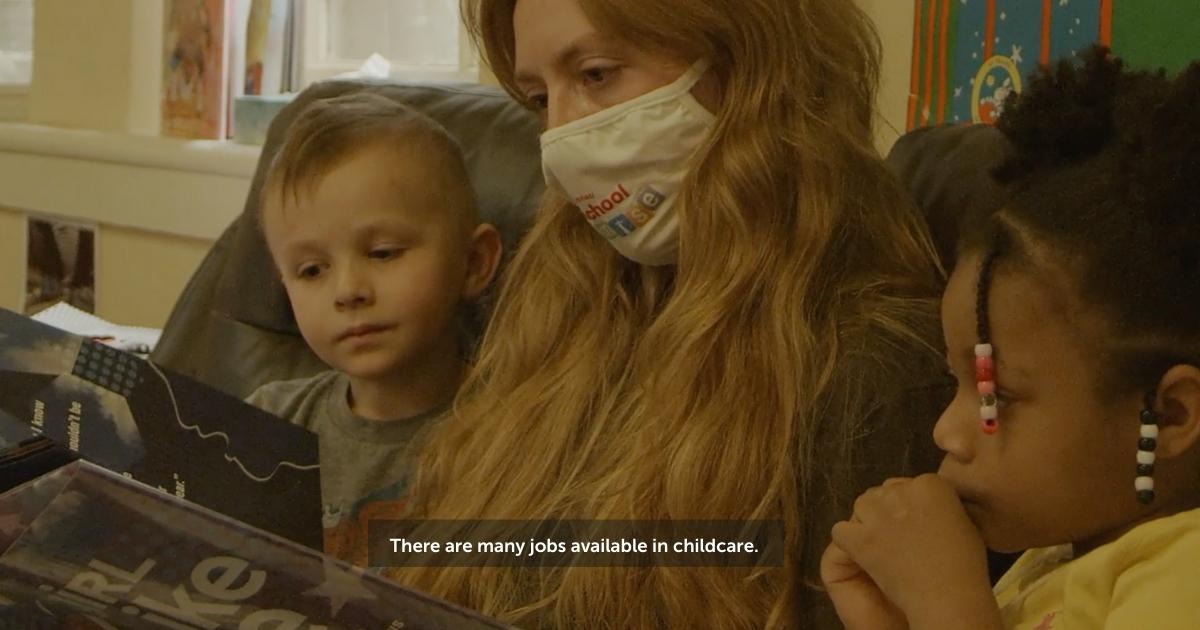Screenshot from video of teacher reading to children